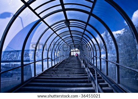 Blue corridor and stairs, people moving - stock photo