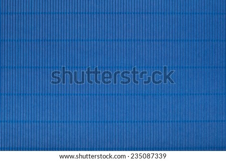 Blue corrugated cardboard carton in a  colorful texture background series. - stock photo