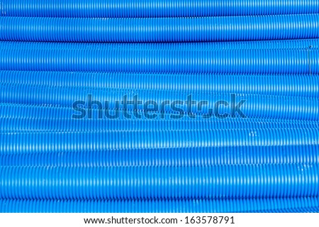 Blue corrugated pipe for electrical high-voltage cables - stock photo