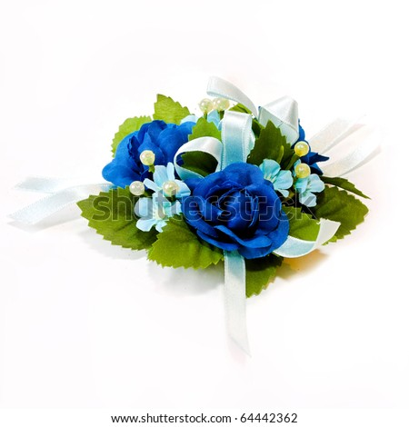 Blue corsage bouquet with pearl ornaments and white ribbon - stock photo