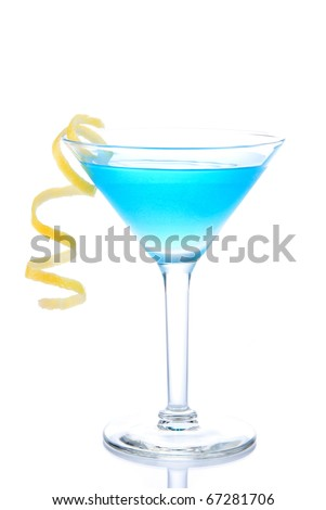 Blue Cosmopolitan cocktail with vodka, blue curacao, white cranberry juice, lime and orange spiral in martini glass isolated on a white background