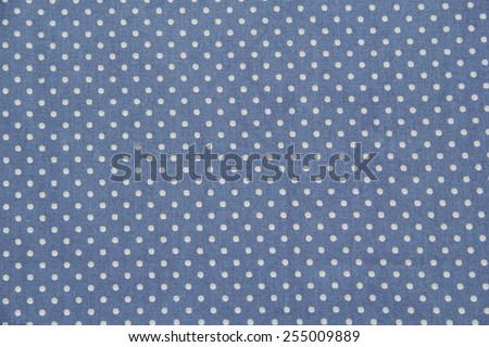 Blue cotton fabric in vintage dots pattern for background or texture - stock photo