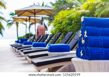 Blue cotton towels at Swimming pool - stock photo