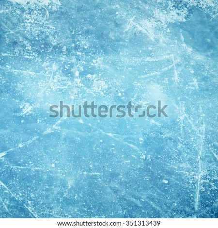 Blue cracked surface of ice background - stock photo