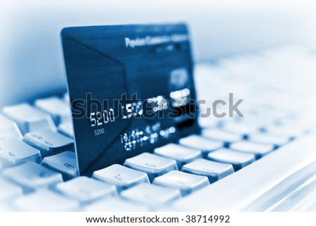 Blue credit card on a computer keyboard 03 - stock photo