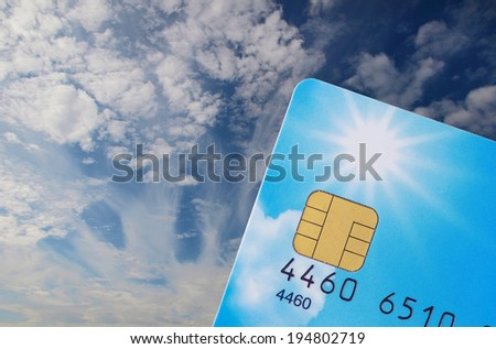 blue credit card with electronic chip against blue sky  - stock photo