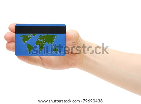 Blue credit card with world map on hand holding - stock photo