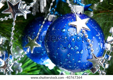Blue cristmas ball baubles with silver decoration on fir tree - stock photo