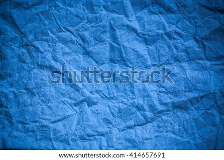 Blue crumpled eco paper background.