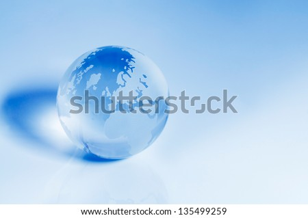 Blue crystal globe focusing on the Europe and Africa area. - stock photo