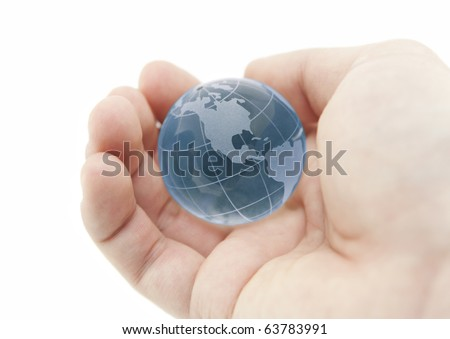 Blue crystal globe in hand with clipping path - stock photo