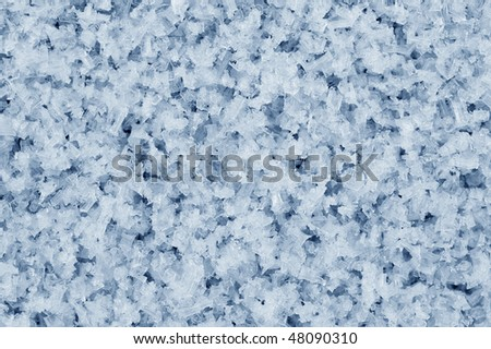 Blue crystals of hoarfrost photographed close-up - stock photo