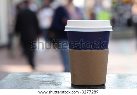blue cup of coffee on a street background - stock photo