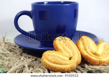 blue cup of tea and two cookies - stock photo