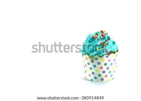 Blue Cupcake with colorful candy on white background