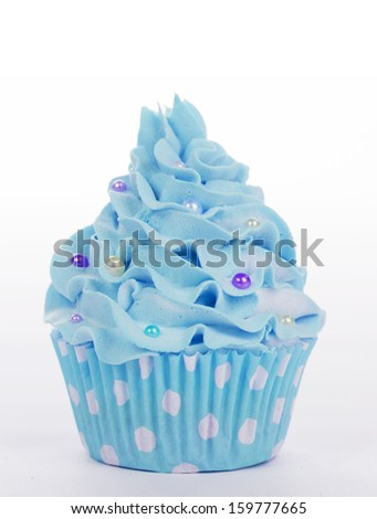 blue cupcake with sprinkles isolated on a white background - stock photo