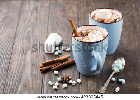 Blue Cups Of Hot Chocolate Drink With Marshmallows And Cinnamon On Dark Wooden Background Winter