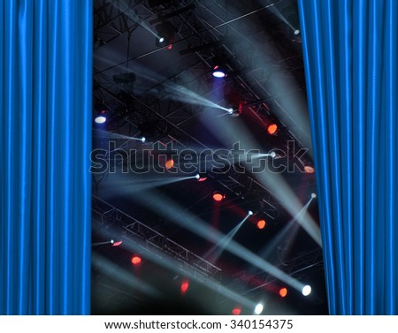 Blue curtain on tconcert stage slightly open - stock photo