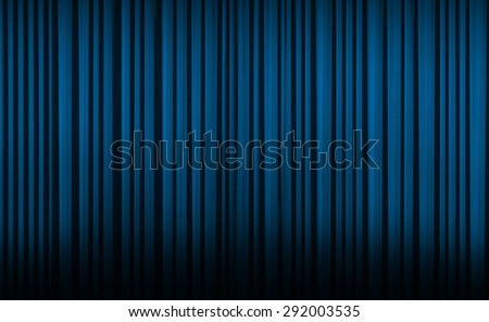 Blue curtain with spot light on theater or cinema stage. - stock photo