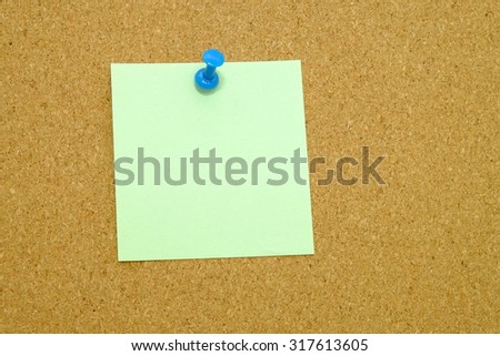 Blue cyan sticky note pinned on cork board background.