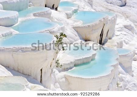 Blue cyan water travertine pools at ancient Hierapolis, now Pamukkale, Turkey - stock photo