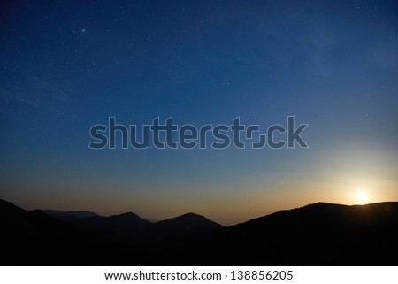 Blue dark night sky with many stars. Moon rising. Space background - stock photo