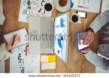 Blue data against creative business team working together - stock photo
