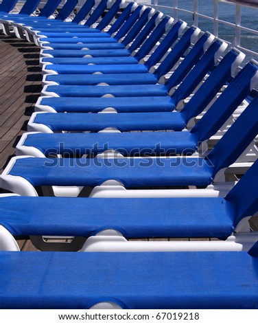 Blue deck-chairs in a row