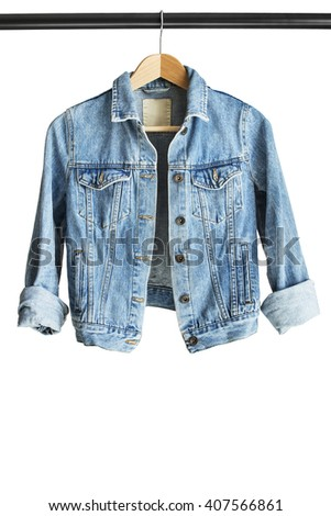 Blue denim jacket hanging on clothes rack isolated over white - stock photo
