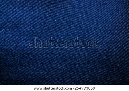Blue Denim Jean Fabric / Concept and Idea of Denim Industry, Sewing and Fashion, Vintage Rustic Style. Vivid Full Frame Pattern, Background, Wallpaper and Textured. - stock photo