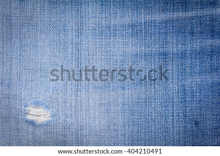 Blue denim jeans texture. blue jean fabric texture. Jeans background. Texture of blue jeans textile close up in vignette with copy space for text or image. - stock photo