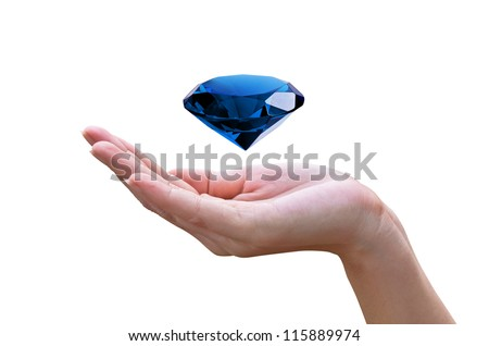 Blue diamond in the hands of women.isolated on white background. Concept most precious beauty.