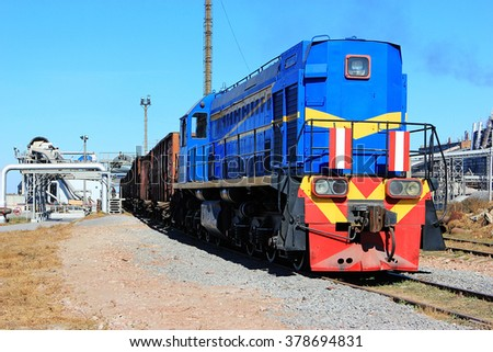 Blue Diesel Locomotive On unloading sugar beet factory for the production of sugar - stock photo