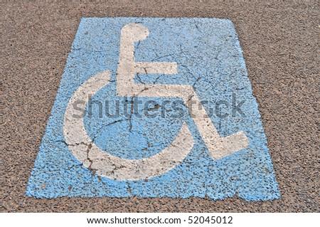 Blue Disability sign on asphalt, underground interior - stock photo