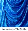 Blue disco glitter reflective fabric sparkling background - stock photo