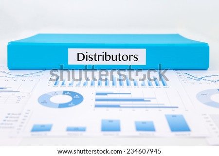 Blue document binder with Distributors word place on graphs analysis and marketing reports