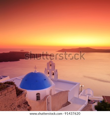 Blue dome Church St. Spirou in Firostefani on the island of Santorini Greece, at sunset - stock photo