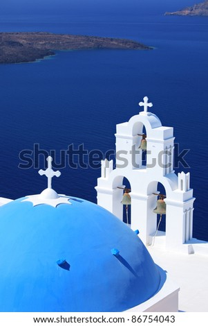 Blue dome Church St. Spirou in Firostefani on the island of Santorini Greece, overlooking the sea - stock photo