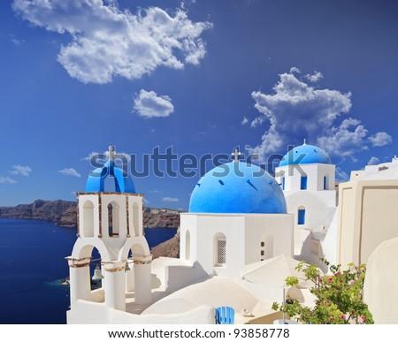 Blue domed church in Oia village on Santorini island, Greece - stock photo