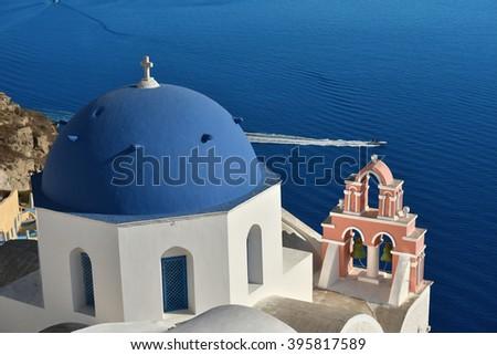 Blue domed church in Oia Village, Santorini, Greece. - stock photo