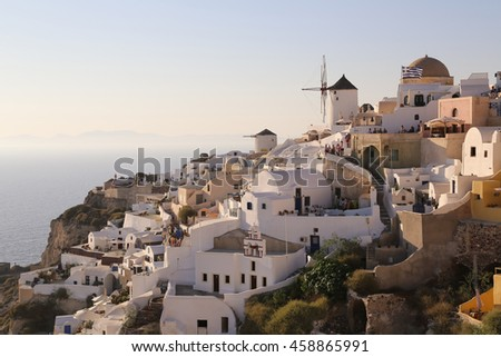 Blue domes and their bell tower in Oia. Santorini - stock photo
