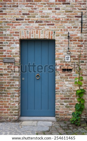 Blue door of a medieval brick house at number 17