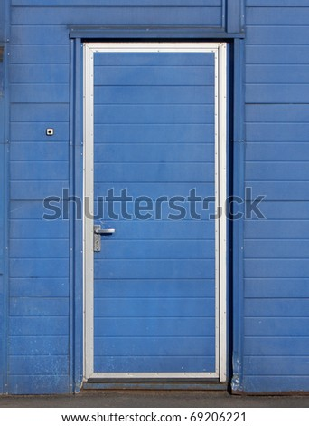 Blue door on the blue wall - stock photo