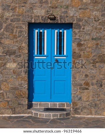 blue door on the stone wall