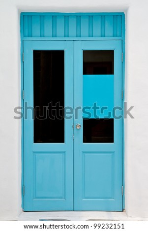 Blue door on white house - stock photo