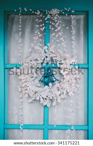 blue door with a white wreath - stock photo