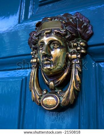 Blue door with gold metal handle - stock photo