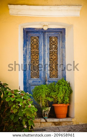 Blue doors and decorative plants, Samos island. - stock photo