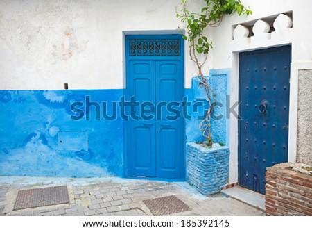 Blue doors and white walls. Old Medina, historical part of Tanger city, Morocco - stock photo