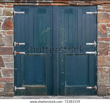 Blue Doors in Stone Wall